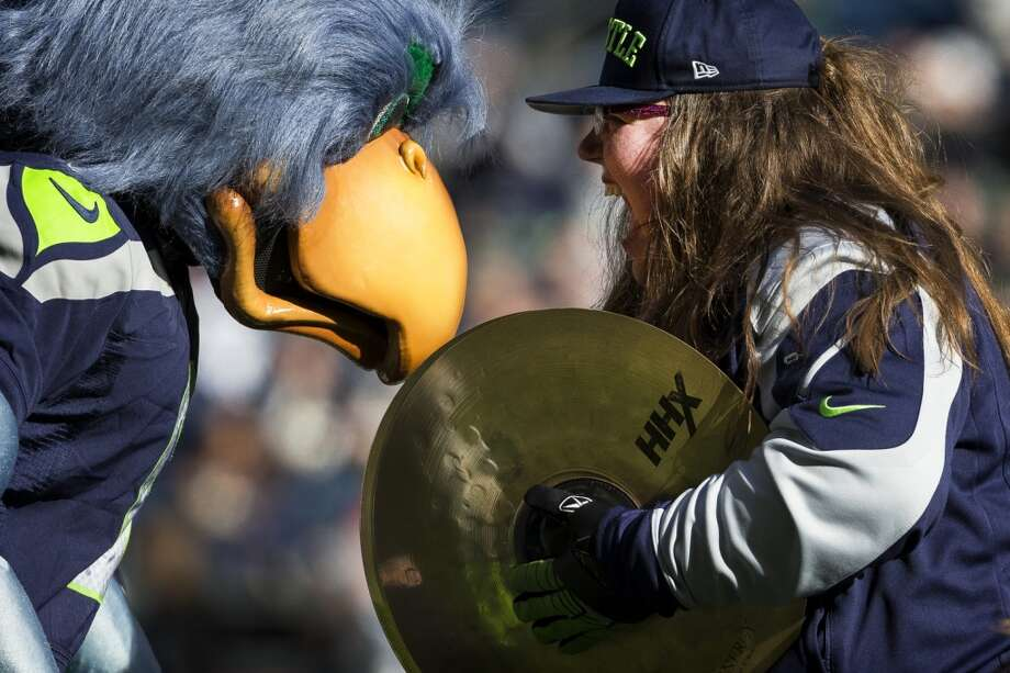 A member of the Blue Thunder band laughs at Blitz the Seahawks' mascot, left, before a game against the Buccaneers Sunday, Nov. 3, 2013, at CenturyLink Field in Seattle. The Seahawks beat the Buccaneers 27-24 during overtime in the biggest comeback in franchise history. (Jordan Stead, seattlepi.com) Photo: JORDAN STEAD, SEATTLEPI.COM