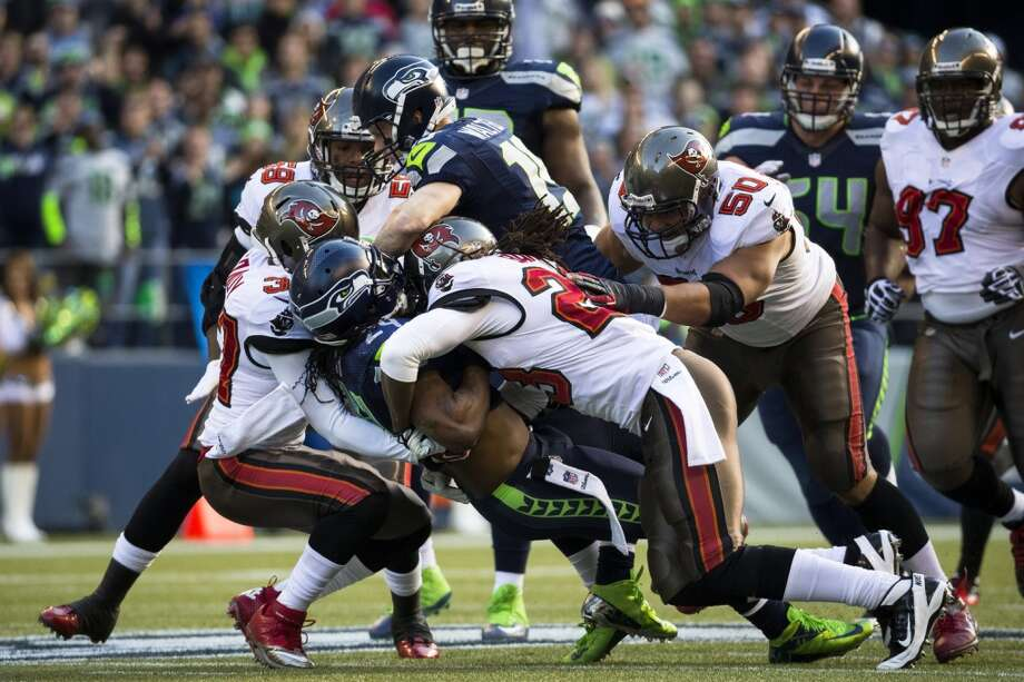 Buccaneers hit Marshawn Lynch from every angle for a tackle Sunday, Nov. 3, 2013, at CenturyLink Field in Seattle. The Seahawks beat the Buccaneers 27-24 during overtime in the biggest comeback in franchise history. (Jordan Stead, seattlepi.com) Photo: JORDAN STEAD, SEATTLEPI.COM