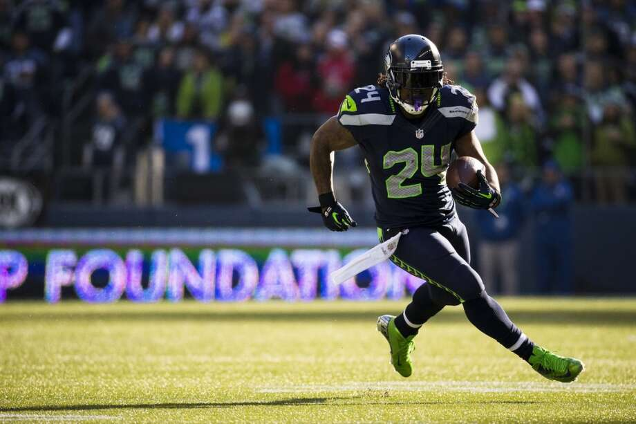 Marshawn Lynch makes a run downfield into a patch of light Sunday, Nov. 3, 2013, at CenturyLink Field in Seattle. The Seahawks beat the Buccaneers 27-24 during overtime in the biggest comeback in franchise history. (Jordan Stead, seattlepi.com) Photo: JORDAN STEAD, SEATTLEPI.COM