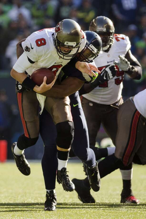 Buccaneers' quarterback Mike Glennon, center left, is sacked by a Seahawk Sunday, Nov. 3, 2013, at CenturyLink Field in Seattle. The Seahawks beat the Buccaneers 27-24 during overtime in the biggest comeback in franchise history. (Jordan Stead, seattlepi.com) Photo: JORDAN STEAD, SEATTLEPI.COM