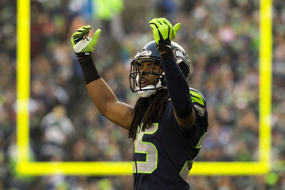 Seahawk Richard Sherman encourages the crowd to show their home team love Sunday, Nov. 3, 2013, at CenturyLink Field in Seattle. The Seahawks beat the Buccaneers 27-24 during overtime in the biggest comeback in franchise history. (Jordan Stead, seattlepi.com) Photo: JORDAN STEAD, SEATTLEPI.COM