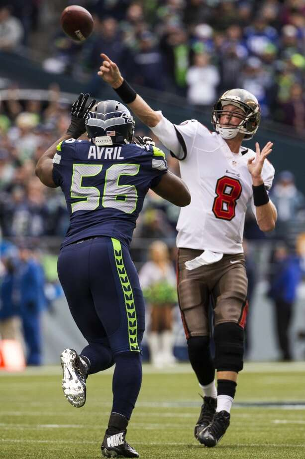 Buccaneers' quarterback Mike Glennon, center right, throws to a teammate over the head of Seahawk Cliff Avril, left, on Sunday, Nov. 3, 2013, at CenturyLink Field in Seattle. The Seahawks beat the Buccaneers 27-24 during overtime in the biggest comeback in franchise history. (Jordan Stead, seattlepi.com) Photo: JORDAN STEAD, SEATTLEPI.COM