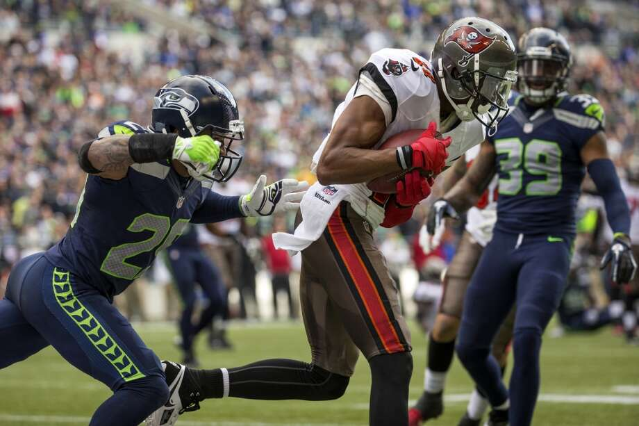 Buccaneer Tiquan Underwood, center, runs a catch into the end zone for a touchdown against the Seahawks Sunday, Nov. 3, 2013, at CenturyLink Field in Seattle. The Seahawks beat the Buccaneers 27-24 during overtime in the biggest comeback in franchise history. (Jordan Stead, seattlepi.com) Photo: JORDAN STEAD, SEATTLEPI.COM