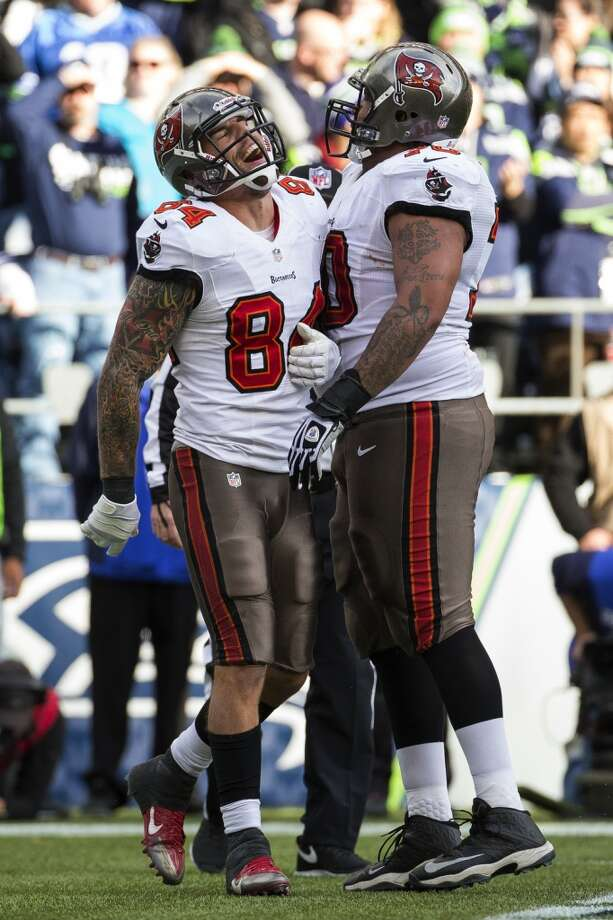 Buccaneer Tom Crabtree, left, reacts after scoring a touchdown against the Seahawks Sunday, Nov. 3, 2013, at CenturyLink Field in Seattle. The Seahawks beat the Buccaneers 27-24 during overtime in the biggest comeback in franchise history. (Jordan Stead, seattlepi.com) Photo: JORDAN STEAD, SEATTLEPI.COM
