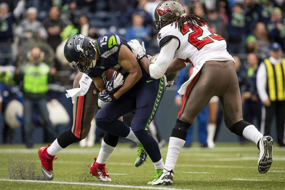 Seahawk Jermaine Kearse, center, pushes through two Buccaneers to score a touchdown Sunday, Nov. 3, 2013, at CenturyLink Field in Seattle. The Seahawks beat the Buccaneers 27-24 during overtime in the biggest comeback in franchise history. (Jordan Stead, seattlepi.com) Photo: JORDAN STEAD, SEATTLEPI.COM