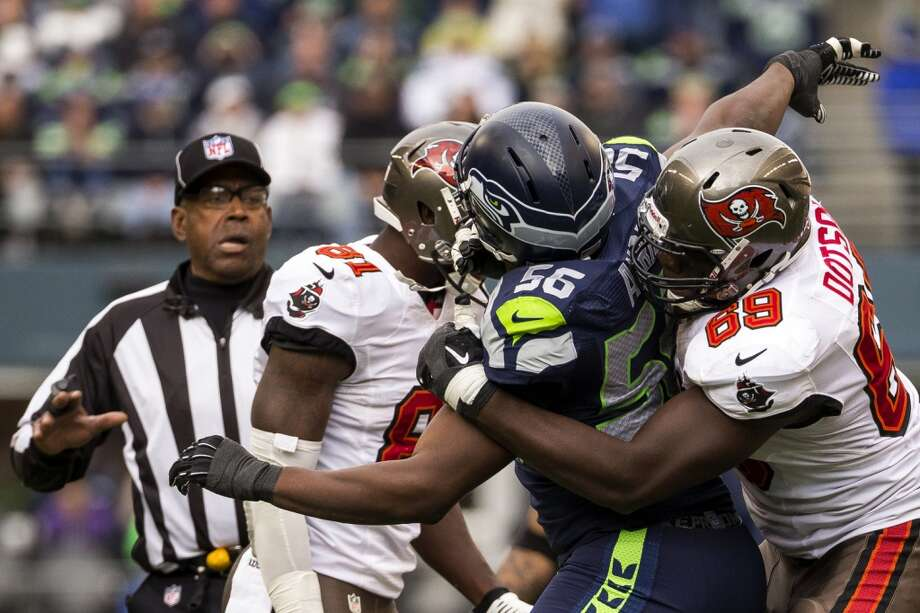 Seahawk Cliff Avril and Buccaneer Demar Dotson scuffle after a tackle Sunday, Nov. 3, 2013, at CenturyLink Field in Seattle. The Seahawks beat the Buccaneers 27-24 during overtime in the biggest comeback in franchise history. (Jordan Stead, seattlepi.com) Photo: JORDAN STEAD, SEATTLEPI.COM
