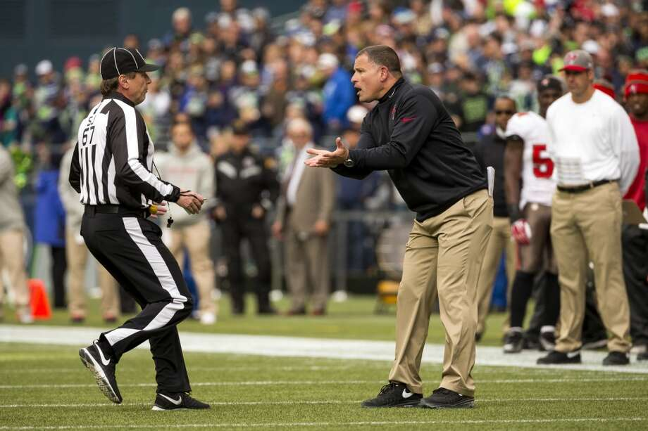 Buccaneers' head coach Greg Schiano, right, argues with a ref after a contested call Sunday, Nov. 3, 2013, at CenturyLink Field in Seattle. The Seahawks beat the Buccaneers 27-24 during overtime in the biggest comeback in franchise history. (Jordan Stead, seattlepi.com) Photo: JORDAN STEAD, SEATTLEPI.COM