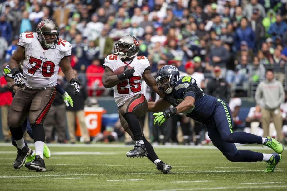Buccaneer Mike James, center, pushes downfield Sunday, Nov. 3, 2013, at CenturyLink Field in Seattle. The Seahawks beat the Buccaneers 27-24 during overtime in the biggest comeback in franchise history. (Jordan Stead, seattlepi.com) Photo: JORDAN STEAD, SEATTLEPI.COM
