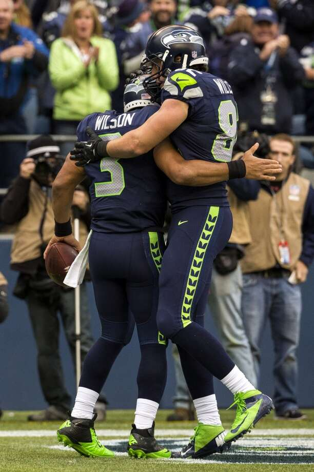 Seahawks quarterback Russell Wilson, left, is congratulated after running in a touchdown for his team Sunday, Nov. 3, 2013, at CenturyLink Field in Seattle. The Seahawks beat the Buccaneers 27-24 during overtime in the biggest comeback in franchise history. (Jordan Stead, seattlepi.com) Photo: JORDAN STEAD, SEATTLEPI.COM