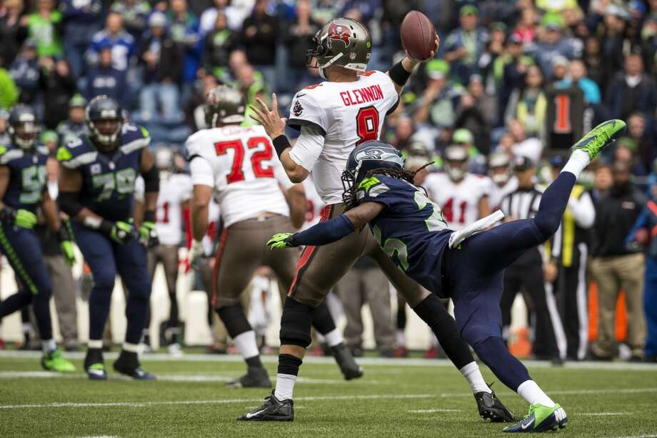 Seahawk Richard Sherman, right, slips while attempting a sack on Buccaneer quarterback Mike Glennon Sunday, Nov. 3, 2013, at CenturyLink Field in Seattle. The Seahawks beat the Buccaneers 27-24 during overtime in the biggest comeback in franchise history. (Jordan Stead, seattlepi.com) Photo: JORDAN STEAD, SEATTLEPI.COM