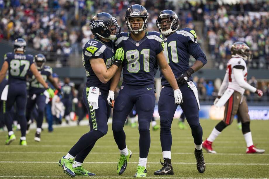 Seahawk Golden Tate, center, is congratulated by teammates after making a 71-yard run against the Buccaneers Sunday, Nov. 3, 2013, at CenturyLink Field in Seattle. The Seahawks beat the Buccaneers 27-24 during overtime in the biggest comeback in franchise history. (Jordan Stead, seattlepi.com) Photo: JORDAN STEAD, SEATTLEPI.COM
