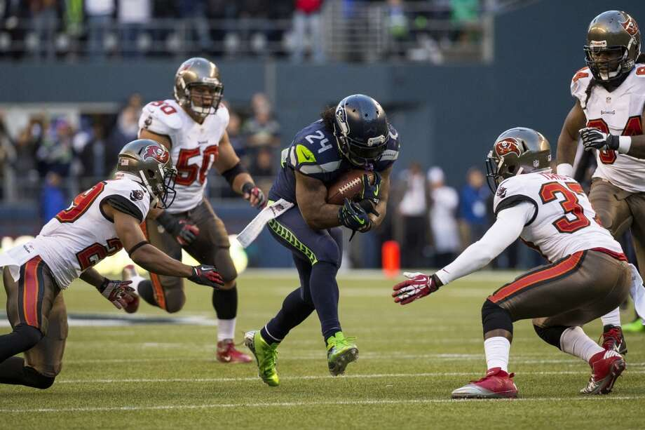 Marshawn Lynch, center, aims for an open hole in Buccaneer defense Sunday, Nov. 3, 2013, at CenturyLink Field in Seattle. The Seahawks beat the Buccaneers 27-24 during overtime in the biggest comeback in franchise history. (Jordan Stead, seattlepi.com) Photo: JORDAN STEAD, SEATTLEPI.COM