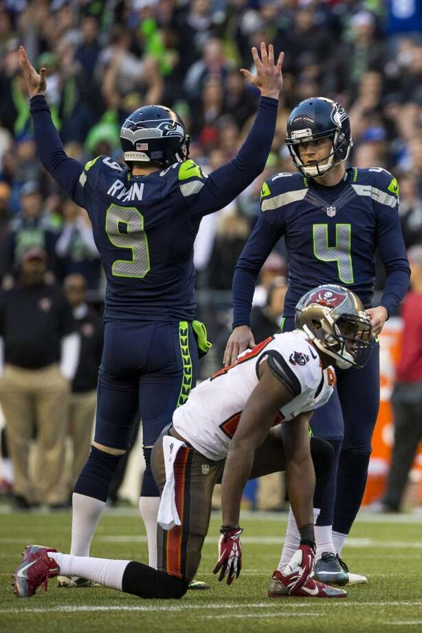 Seahawks kicker Steven Hauschka, right, turns to punter Jon Ryan, left, to celebrate Hauschka's winning field goal against the Buccaneers in overtime Sunday, Nov. 3, 2013, at CenturyLink Field in Seattle. The Seahawks beat the Buccaneers 27-24 in the biggest comeback in franchise history. (Jordan Stead, seattlepi.com) Photo: JORDAN STEAD, SEATTLEPI.COM