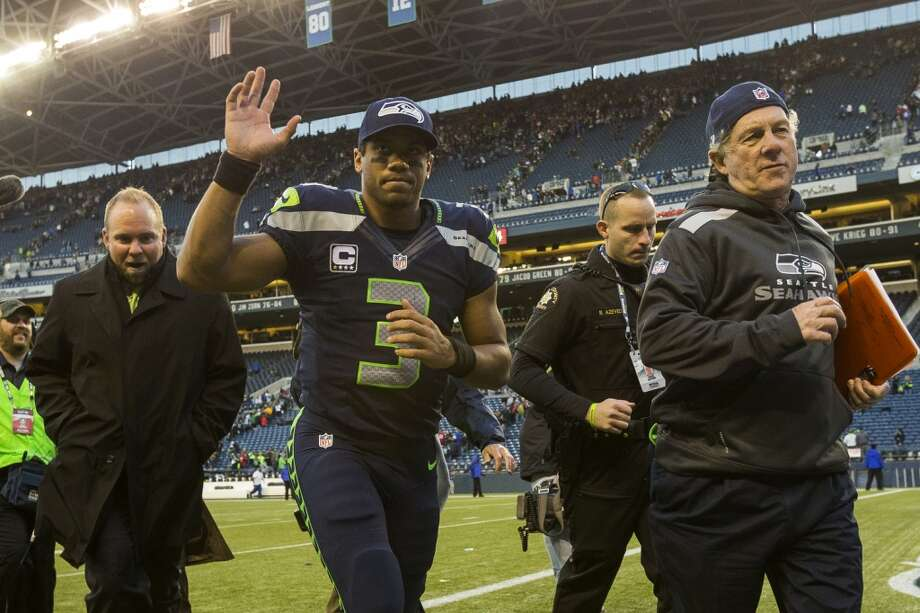 Seahawks quarterback Russell Wilson, center left, leaves the field following a victory over the Buccaneers Sunday, Nov. 3, 2013, at CenturyLink Field in Seattle. The Seahawks beat the Buccaneers 27-24 during overtime in the biggest comeback in franchise history. (Jordan Stead, seattlepi.com) Photo: JORDAN STEAD, SEATTLEPI.COM