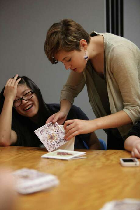 Alicja Zapalska, right, 17, helps Jade Klingler, 17, bind one of the 100 editions of Eight, which is the literary magazine at The High School for Visual and Performing Arts. The girls are junior students taking the courses as part of the high school's creative writing program. Photo: Marie D. De Jeséºs, Staff / © 2013 Houston Chronicle