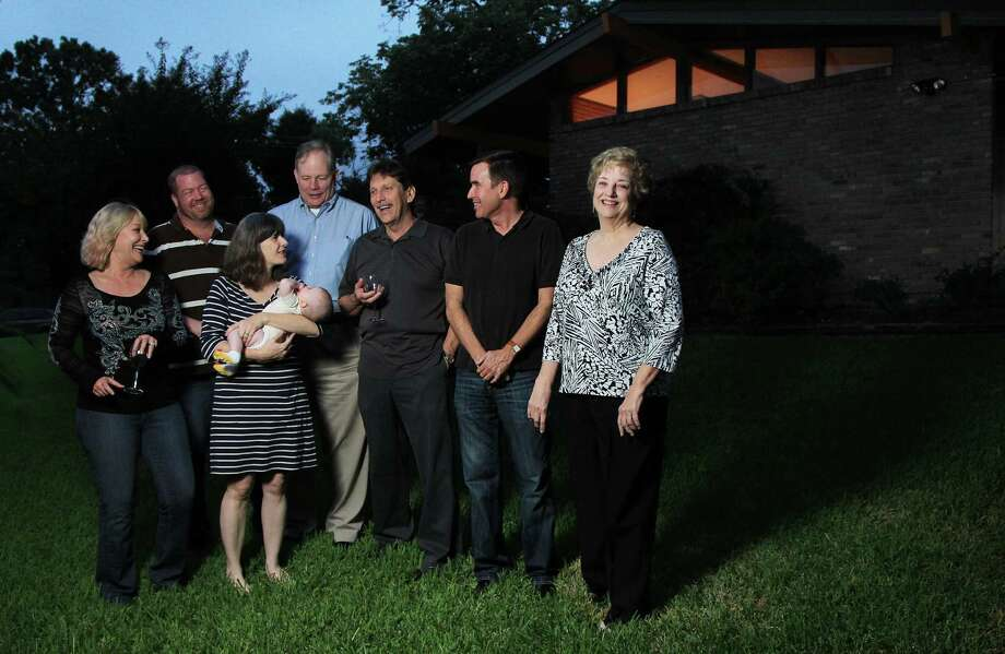 From left: Cathy Sessums, Don Dorcey, Lindsey Horne carrying Ellen Horne, 4 months, Mike Morse, Johnny Sessums, Robert Searcy and Ann Collum, are residents of the Glenbrook Valley neighborhood. Photo: Mayra Beltran, Staff / © 2013 Houston Chronicle