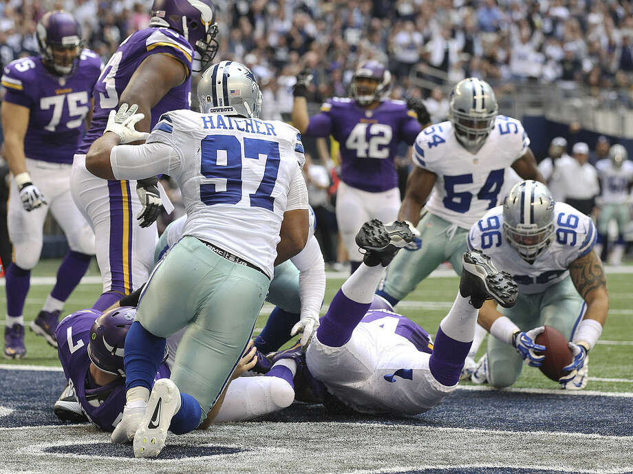Cowboys defensive tackle Nick Hayden falls on a fumble by Christian Ponder after the Vikings' quarterback was sacked in the end zone during the second half. It was Dallas' fourth defensive TD of the season. Photo: Jerry Lara / Express-News