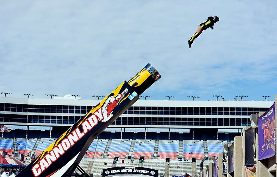 FORT WORTH, TX - NOVEMBER 03:  Cannonlady Jennifer Schneider is fired from a cannon as part of pre-race festivities during the NASCAR Sprint Cup Series AAA Texas 500 at Texas Motor Speedway on November 3, 2013 in Fort Worth, Texas.  (Photo by Robert Laberge/Getty Images for Texas Motor Speedway) Photo: Robert Laberge, Getty Images For Texas Motor Spe