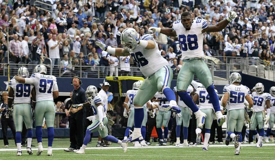 Dallas' Nick Hayden (96) and receiver Dez Bryant (88) celebrate after the defensive tackle recovered a fumble in the end zone vs. the Vikings at AT&T Stadium. Photo: Jerry Lara / San Antonio Express-News
