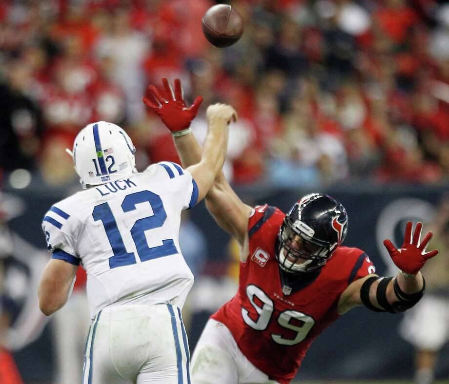 Colts QB Andrew Luck, who in two years has eight fourth-quarter comebacks to his credit, engineered two wins over the Texans and J.J. Watt (99) this season. Photo: Brett Coomer, Staff / © 2013  Houston Chronicle