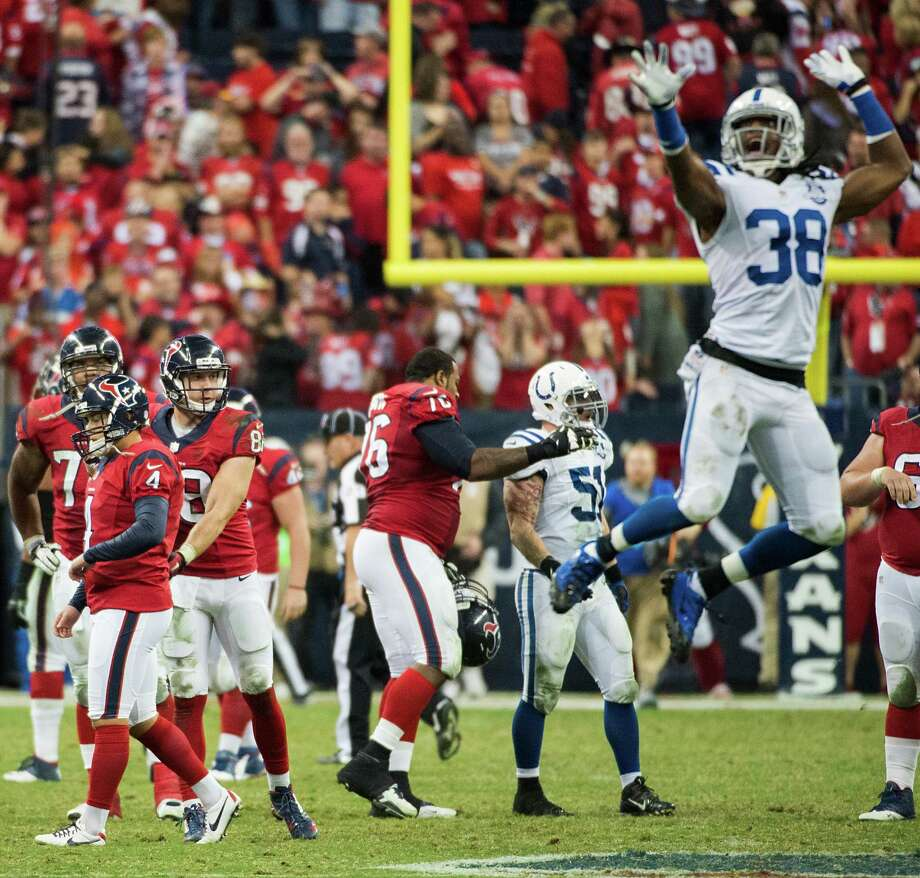 Indianapolis Colts defensive back Sergio Brown (38) is ready to celebrate after Texans kicker Randy Bullock (4) missed a 55-yard field-goal attempt on the final play Sunday night. It was the third miss of the night for Bullock. Photo: Smiley N. Pool, Staff / © 2013  Houston Chronicle