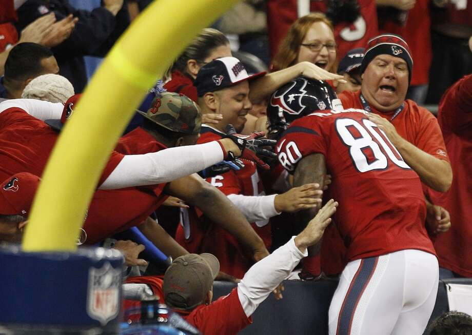 Week 9: Colts 27, Texans 24Texans wide receiver Andre Johnson celebrates with fans after scoring on a 62-yard pass. Photo: Brett Coomer, Houston Chronicle