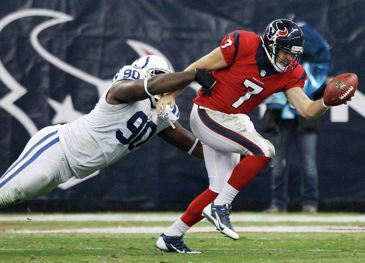Showing mobility the Texans have not been accustomed to at quarterback, Case Keenum (7) scrambles away from Colts defensive end Cory Redding (90) during Sunday night's third quarter.