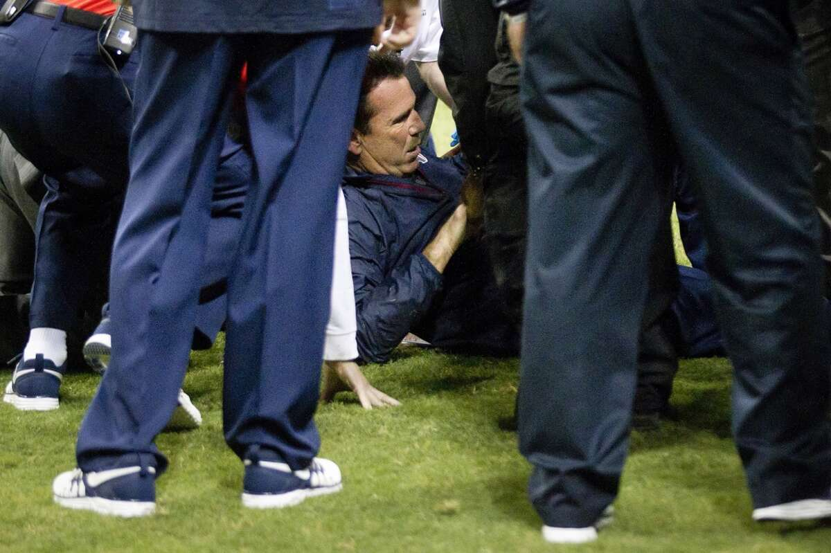 Gary Kubiak receives medical attention after he collapsed on the field at the end of the first half.