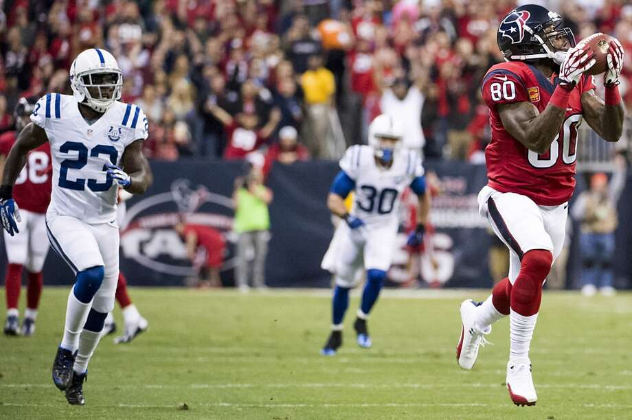 Texans wide receiver Andre Johnson catches a 62-yard touchdown pass from Case Keenum during the first quarter. Photo: Smiley N. Pool, Houston Chronicle