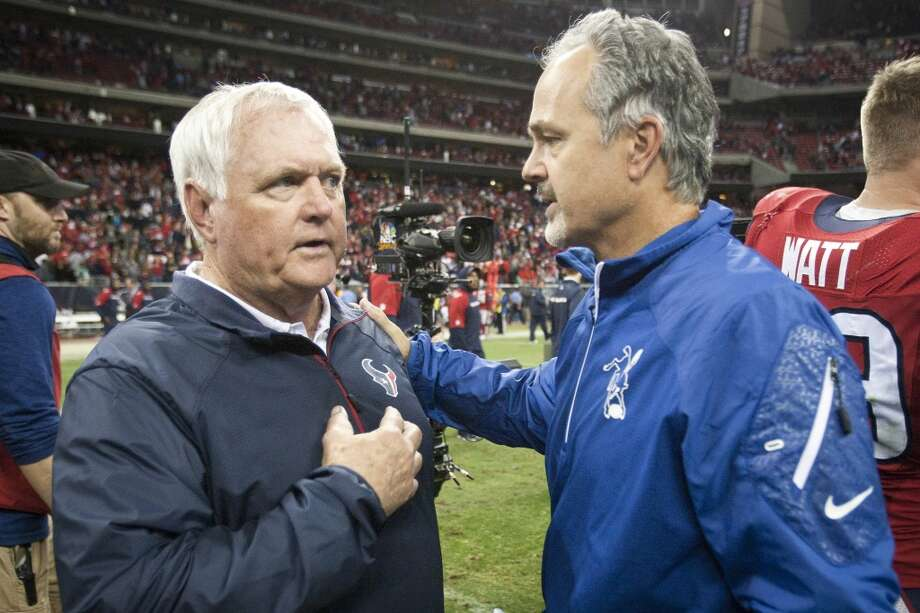 Texans defensive coordinator Wade Phillips, left, talks to Colts head coach Chuck Pagano about the status of Texans head coach Gary Kubiak following the game. Photo: Brett Coomer, Houston Chronicle