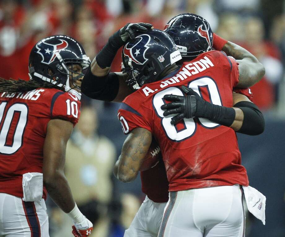 Texans wide receiver Andre Johnson celebrates with teammates after scoring on a 41-yard touchdown pass during the first quarter. Photo: Brett Coomer, Houston Chronicle