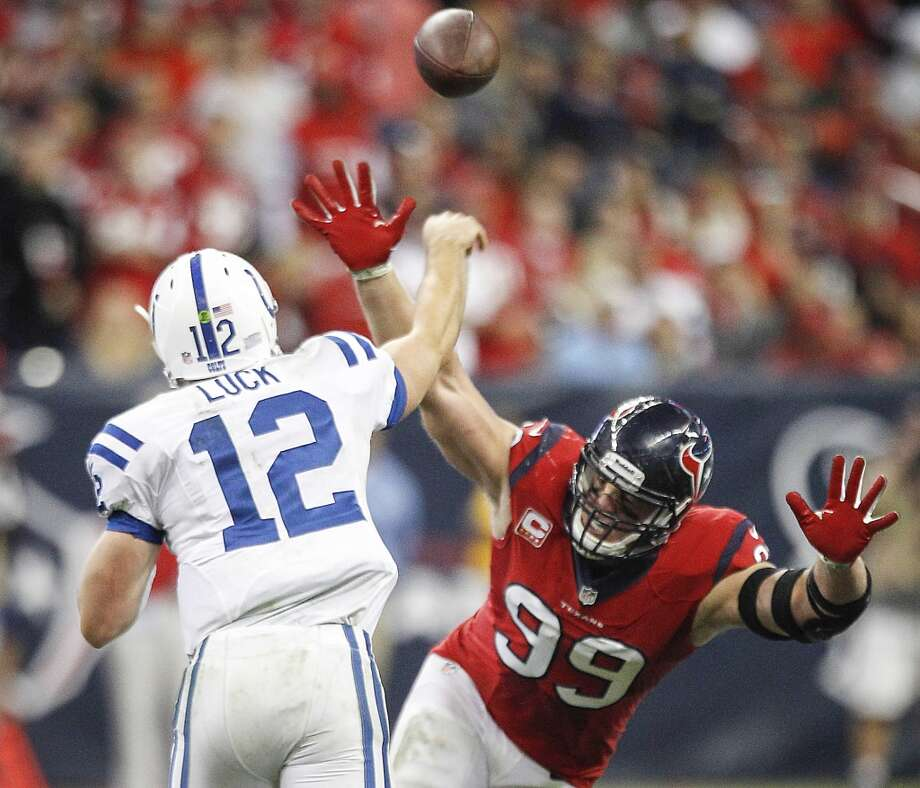 Colts quarterback Andrew Luck gets off a pass under pressure from Houston Texans defensive end J.J. Watt . Photo: Brett Coomer, Houston Chronicle