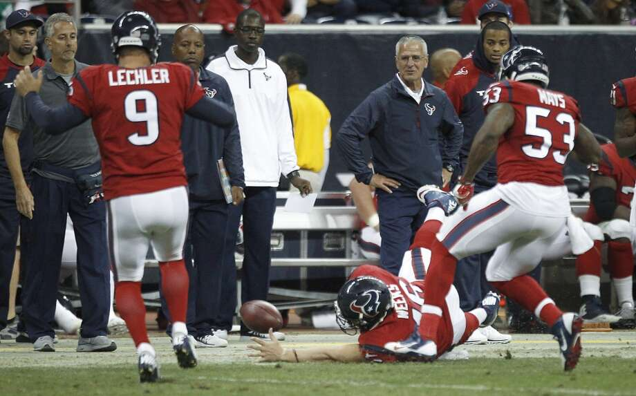 Texans long snapper Jon Weeks (46) dives to stop the bounce of a punt by Shane Lechler (9) against the Colts. Photo: Brett Coomer, Houston Chronicle