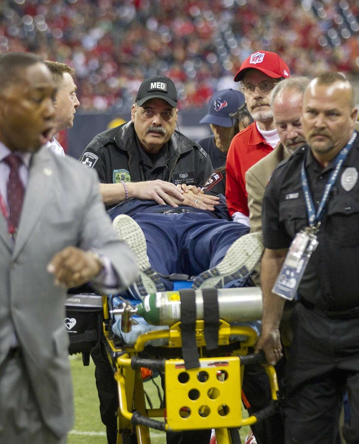 Texans head coach Gary Kubiak leaves the field on a stretcher after he collapsed on the field at the end of the first half.
