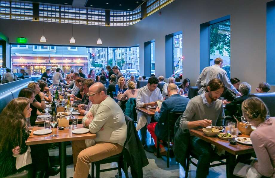 Diners enjoy dinner at 1760. Photo: John Storey, Special To The Chronicle