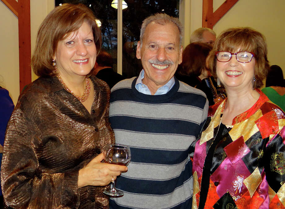 At the Fairfield Foundation for Education wine tasting on Saturday were, from left, event co-chairwoman Val Foster; grants committee member Jeff Ackerman, and foundation founder Ann Clark, a former Fairfield school superintendent. Photo: Mike Lauterborn / Fairfield Citizen contributed
