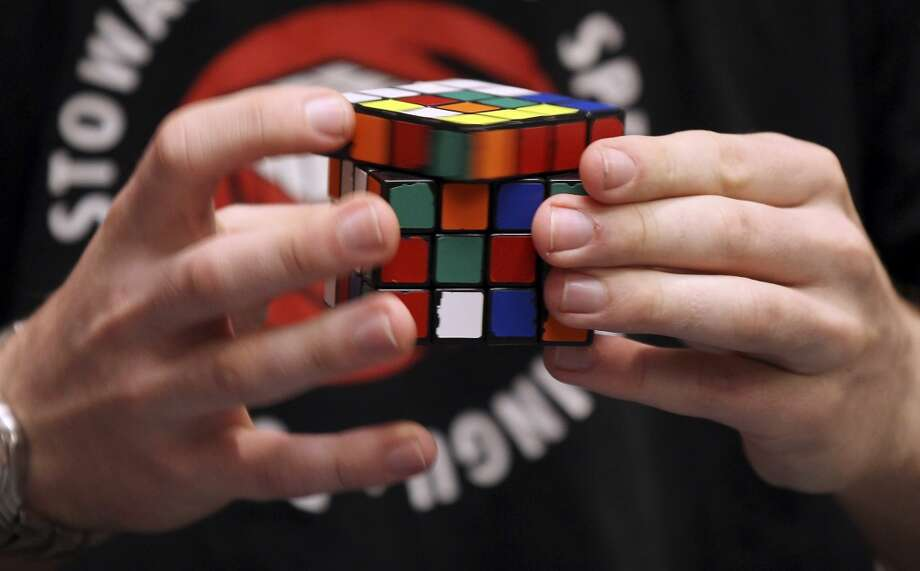 Contestants compete during the 2012 World Cube Association's U.S. National Championship at the Riviera Hotel and Casino in Las Vegas, Aug. 4, 2012.  (Isaac Brekken/The New York Times) Photo: ISAAC BREKKEN, NYT