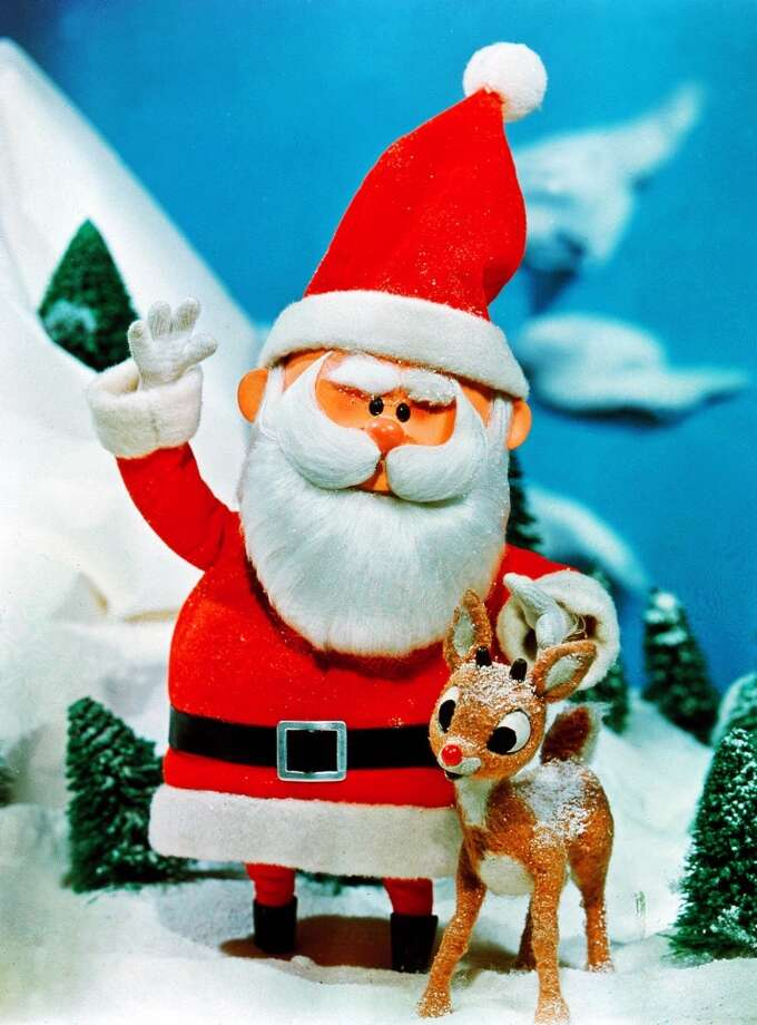 Santa stands beside his favorite reindeer, Rudolph, in a scene from  'Rudolph the Red-Nosed Reindeer,' television's  longest-running special. Photo: AP