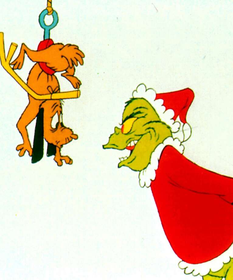 The Grinch and his canine cohort, Max, plot against the residents of Whoville in the animated special ``Dr. Seuss' How the Grinch Stole Christmas''