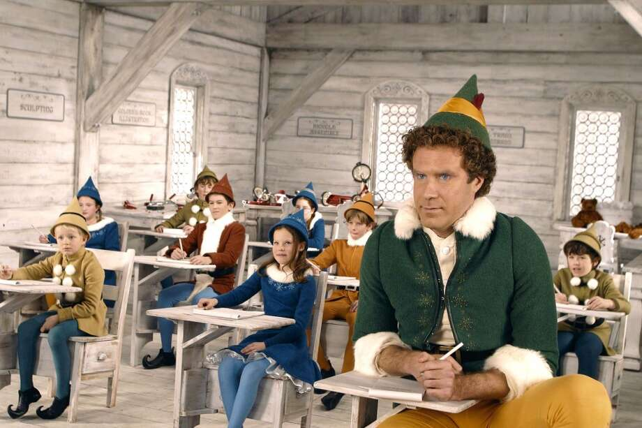 "Will Ferrell (right) stars as Buddy the Elf in New Line Cinemas "" Elf. ""  (AP Photo/ Alan Markfield/New Line Productions ) Photo: ALAN MARKFIELD, AP"