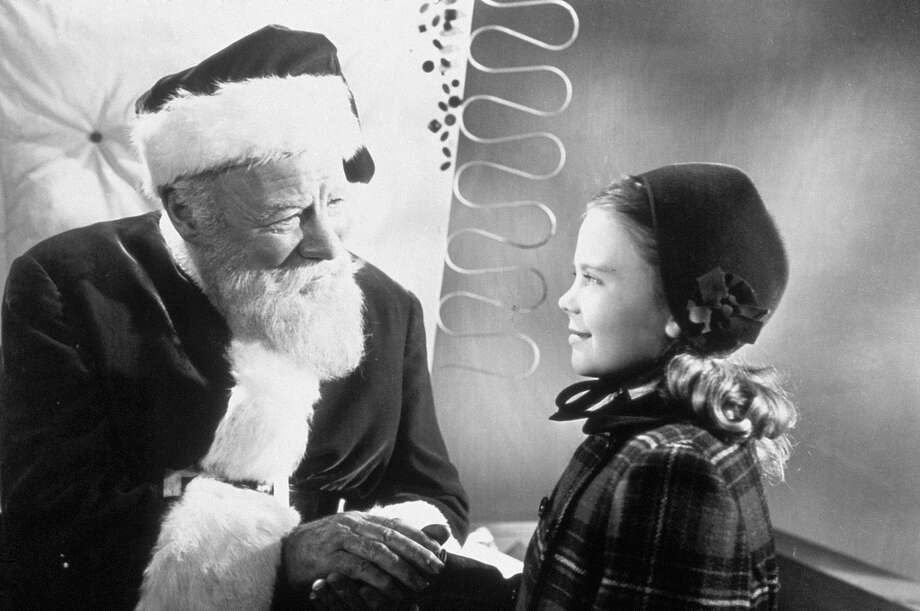 "** FILE ** This undated promotional file photo provided by Fox Home Entertainment shows Actor Edmund Gwenn (left) as Kris Kringle greeting actress Natalie Wood in a scene from the 1947 film ""Miracle on 34th Street."" (AP Photo/Fox Home Entertainment. File) Photo: AP"