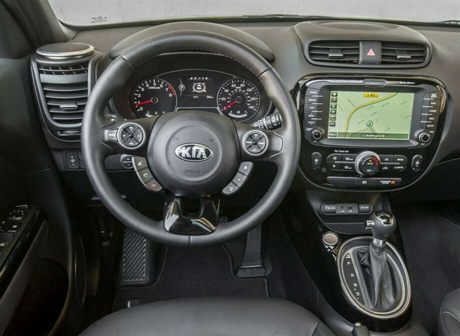 The 8-inch touchscreen is bigger than many tablets. There's another LED screen in behind the steering wheel. Photo: Kia