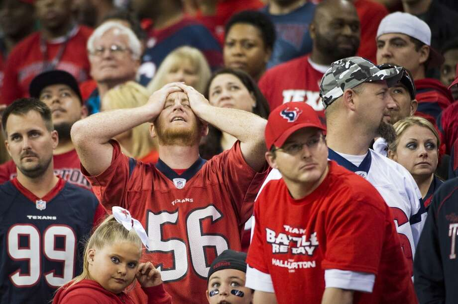 Texans fans react after a Colts score late in the fourth quarter. Photo: Smiley N. Pool, Houston Chronicle