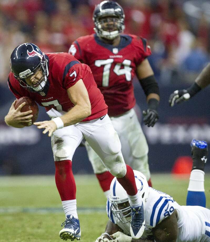 Texans quarterback Case Keenum scrambles past Colts defensive end Ricky Jean Francois for a first down to set up a touchdown during the first half. Photo: Cody Duty, Houston Chronicle