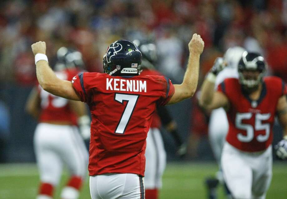 Texans quarterback Case Keenum celebrates after throwing a 62-yard touchdown pass to Andre Johnson. Photo: Cody Duty, Houston Chronicle