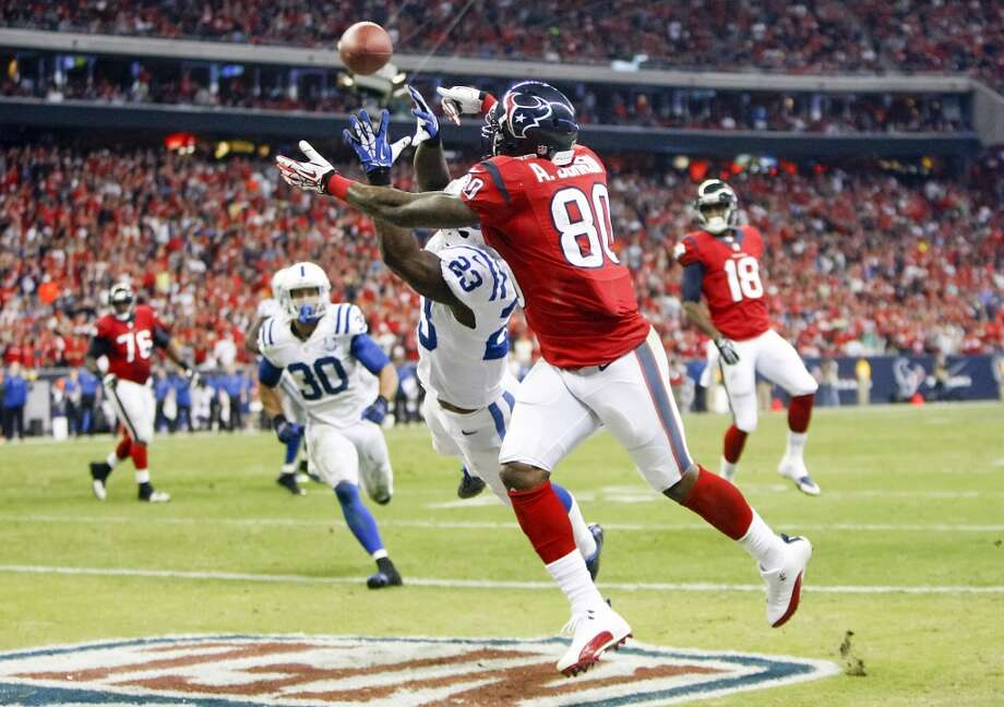 Texans wide receiver Andre Johnson (80) catches a 5-yard touchdown pass as Colts cornerback Vontae Davis (23) defends. Photo: Cody Duty, Houston Chronicle