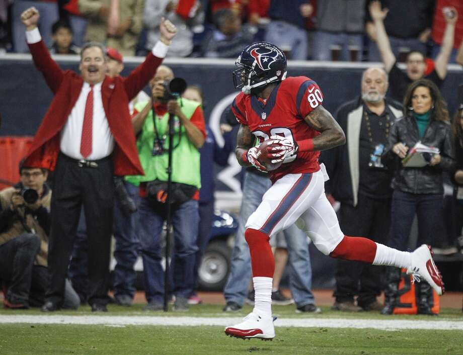 Texans wide receiver Andre Johnson gets a cheer from team vice chairman Cal McNair as he scores on a pass play during the first quarter. Photo: Brett Coomer, Houston Chronicle