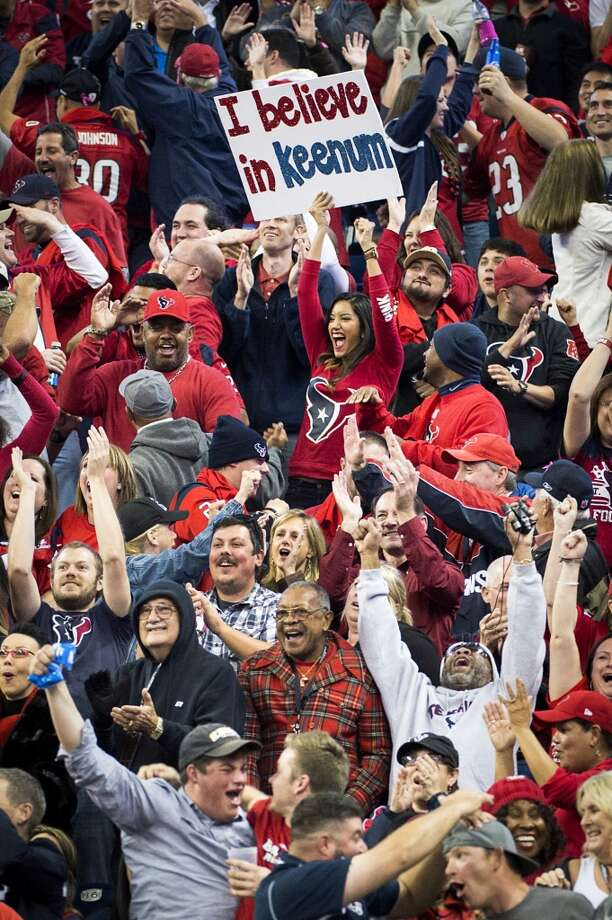 Texans fans celebrate after quarterback Case Keenum threw his third touchdown pass of the game. Photo: Smiley N. Pool, Houston Chronicle