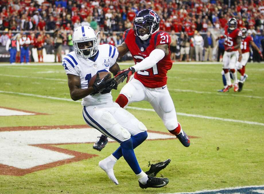 Colts wide receiver T.Y. Hilton (13) catches a 10-yard touchdown pass as Texans cornerback Brice McCain (21) defends. Photo: Cody Duty, Houston Chronicle