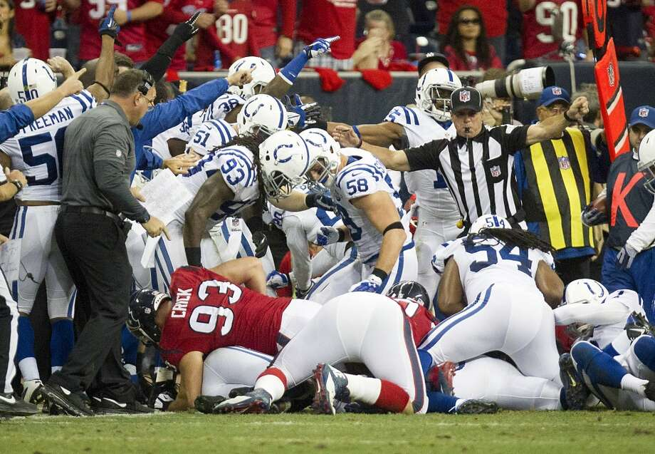 Players scramble for a Texans fumble that was originally ruled as recovered by the Colts but was overturned on review. Photo: Cody Duty, Houston Chronicle